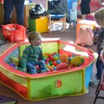 Children playing in a ball pit at Ipswich High School's Parent and Toddler Group
