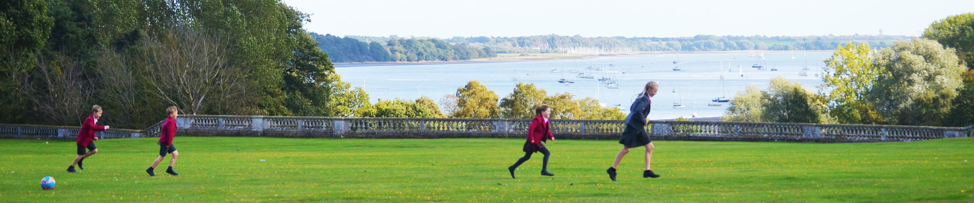 Ipswich High School pupils playing on the back lawn, overlooking the River Orwell